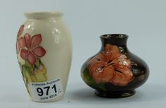 Collectors & General Auction – Lot 971 – Moorcroft Hibiscus on brown ground vase 8cm together with wild flower on cream vase 11cm (2).  Sale Price: £50.00