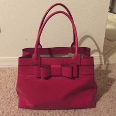 ✳️NWT✳️Kate Spade 'Charm City Ostrich' Diehl Tote Such a gorgeous bag!!!... This beauty is brand new... It's called Diehl from the Charm City Ostrich Collection and is in the color 'Dynasty Red'... It has 3 main compartments (the middle is zippered), 2 small cellphone/lipstick pockets in the inside front, and a smaller zippered pocket at the back... It's got a super cute red bow on the front and the standard Kate Spade gold tag on the back... It retails for $498. kate spade Bags Totes