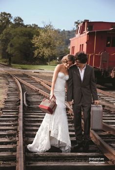 Railroad wedding pictures-- do this without the luggage-- I just like the way her head is leaning into him and they way they look so happy together.