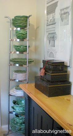 Vertical Dinnerware Storage - love the idea but the cat may love it too...
