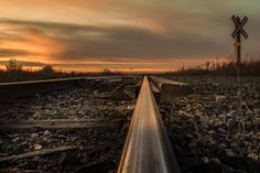Railroad track down low on the SK prairie at sunset.