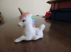Pastel Unicorn Figurine with Gold Horn  - laying down - Small (only a few inches) - Ceramic - Vintage