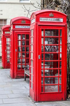 A row of three classic red phone boxes in Bloomsbury, London. #london #bloomsbury #redphonebox