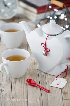Tea Time - a heart teapot with two white cups of tea, in a wood background
