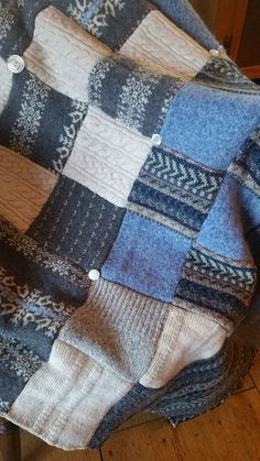 This wool throw quilt is crafted from wool sweaters sourced from my local thrift store. The sweaters are felted, deconstructed and cut into quilt squares. I machine stitch the throw top, but attach the backing entirely by hand using a contrasting blanket stitch. This throw is approximately 40x60, and done in shades of soft gray, cream and blue. The backing is a soft gray fleece. This would make the perfect gift for someone special, or a wonderful treat for yourself. Thank you for visiting…