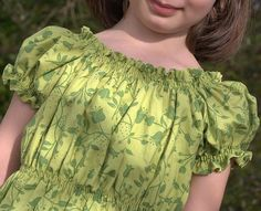 Peasant-style dress - I've made several of these. One with a casing for elastic at the neckline, no shirring at all on it, and no waistband so that it was a nightgown. Another exactly as the pattern calls for it to be made, one cut short as a shirt, and another with no bottom ruffle. Love this pattern! :)