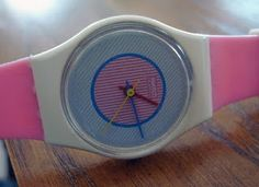 had me a white swatch watch with a rubber band thing to protect the face of watch