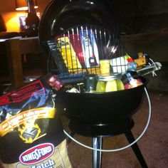 Nice presentation and item selection on a BBQ Basket -From Original Pinner -  BBQ basket I made for a silent auction at a benefit! Includes grill, charcoal, sauces, marinades, rubs, seasonings, utensils, grill brush, grill mitt, corn on the cob skewers, grill lighter, and a pickle and veggie mixture.