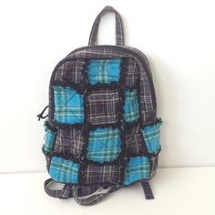 Mini plaid black blue book bag WELCOME to my addiction.  I always have NEW items posted frequently so please keep checking back :-)!  BUNDLES are more than welcome and encouraged to save you shipping!  Please refer to description and photos to see fit.   BRAND: none  COLOR: black blue gray  CONDITION: used   Measurements  STRAP: 16 in and are adjustable a little bit  HEIGHT: 12 in LENGTH: 10 in WIDTH: 4 in DEPTH: 13 in  Other details: 100% cotton. Made in China. Plaid pattern. Zipper zips up…