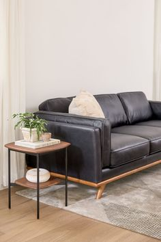 Imagine this leather sofa centered on an accent wall or flaunting a beautiful throw. The Timber will inspire you to explore — even if your journey only goes as far as the pantry. With its honey oak stain trim, feathery cushions, and full-aniline dye process, the Timber is sinkable and plush but cleans up real nice. #LeatherSofa #BlackLeather #ModernSofa Leather Sofa, Black Leather, Stained Trim, Black Sofa, Oak Stain, Modern Sofa, Vintage Looks, Pantry, Honey