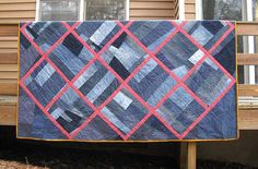 denim quilt. I love the red sashing and the simple crazy denim blocks.