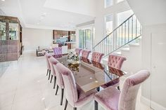 The Bohlig Residence located in Glendale, California |Modern and stunning. Large windows offer breathtaking views of the city and hills; the decor is contemporary with tiled floors, modern furnishings and glass tables. #kidandcoe #bringthekids #propertyoftheday