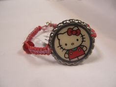 Hello Kitty upcycled bottle cap hemp bracelet - This item and others like it are for sale by Hemptress Designs! To view our online stores, please visit hemptressdesigns.com