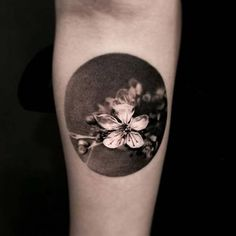 3d cherry blossom tattoo on the forearm
