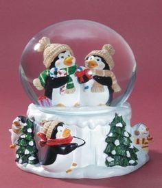 Penguin Musical Snow Globe - We Wish You a Merry Christmas by WLM, http://www.amazon.com/dp/B002VGT7IM/ref=cm_sw_r_pi_dp_w9SUqb03764MQ