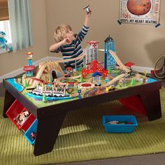 A train table set will provide your toddler with interactive features and a safe play area & $155 Hayneedle sale KidKraft Metropolis Train Set Table with Trundle ...