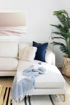 My new favorite napping spot is on the Interior Define Caitlin Sofa for my living room makeover.