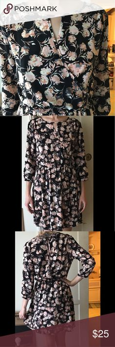 Lush Floral Long Sleeved Dress Lush floral long sleeved dress from Nordstrom. 100% polyester. Size Small. Only worn once! Small opening in back and wrap detail in the front. Very comfortable and classy. Lush Dresses Long Sleeve