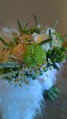 Orchud chic bridal handtied bouquet of thalea roses, akito roses, viburnum, white veronica, daisy and green hypericum.