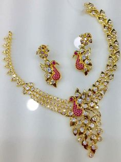 Very beautiful peacock design AD and Ruby stone necklace with matching earrings . Whatsap to 09581193795 for more details . Peacock Jewelry, Coral Jewelry, Fine Jewelry, Saphir Rose, Gold Wedding Jewelry, Peacock Design, Ruby Stone, Indian Jewelry, Ethnic Jewelry
