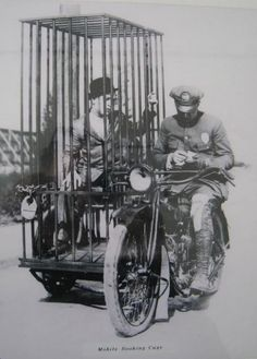"Check out this Harley-Davidson sidecar ""mobile booking cage/portable jail cell"" from the 1920s. How about a caption for this photo?"