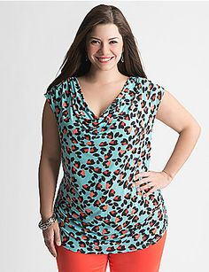 What could be more flattering than a sexy draped neck top with shirred sides? Simply add an alluring animal print, and you're all set for a sassy Spring! Cap sleeves. lanebryant.com