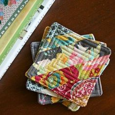 Quilted Coasters {Home Accessories}These quilted coasters are beautiful! Plus if you like to quilt, it will be a fun little project to make to help accessorize your home! Tie a few of them up with a ribbon and they could also make a fabulous house warming gift!View This Tutorial