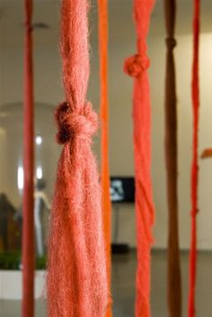 """Cecilia Vicuña (Chilean artist) """"Quipu Menstrual"""": 28 hebras de vellón sin hilar. En el pensamiento andino, el vellón sin hilar es la energía del cosmos, puro potencial."""