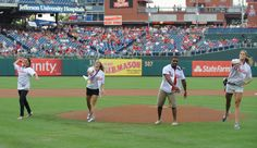 2012 Olympic gold medalists Carli Lloyd, Heather Mitts, Jordan Burroughs and Susan Francia throw out a ceremonial first pitch on August 24th