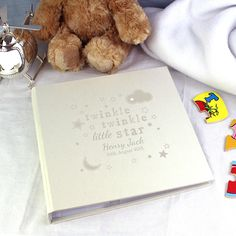 """This Twinkle Twinkle Album with Sleeves can be personalised with a name up to 20 characters and a date up to 20 characters. The text 'Twinkle Twinkle little star' is fixed. The personalisation is case sensitive and will appear as entered.   There are 25 sleeved pages (50 sides), in this deluxe satin sheen finish bookbound album.  The flexibility of the sleeves allow up to 2x (6"""" x 4""""), 1x (7"""" x 5"""") or 1x (8"""" x 6"""") photos per page.  Ideal for Birthdays, Christenings, New born."""
