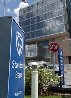 Standard Bank reported a 27 percent rise in full-year profit on Thursday, but said that a possible downgrade of South Africa's sovereign credit rating to 'junk' would affect its performance.