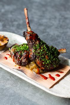 Learn how to barbecue lamb chops and find out what barbecued lamb chops go with in this handy guide to barbecuing lamb chops from Great British Chefs. Lamb Chop Recipes, Meat Recipes, Gourmet Recipes, Cooking Recipes, Lamb Dishes, Food Dishes, Barbecue Recipes, Grilling Recipes, Grilling Art