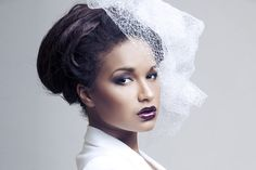 Check out these 20 gorgeous black wedding hairstyles pictures! We've got updos, hair worn down, half up, curls and more! Add a veil for that bridal look.