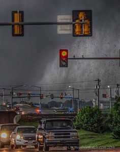 Photographer's text: Edge of violent tornado begins to cross 19th street in Moore, OK - May 20, 2013. While the event itself was sickening, this was my best shot to give someone a feeling of what it might be like to be in the path of such a thing.