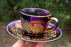 Mouse over image to zoom Have one to sell? Sell it yourself Northwood GRAPE & CABLE ANTIQUE CARNIVAL GLASS CUP & SAUCER SET~ELECTRIC PURPLE
