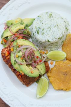Grilled salmon with avocado salsa, cilantro lime rice, and patacones/tostones