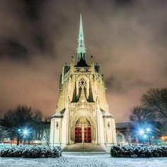 Heinz Chapel in #pittsburgh glows in the early morning snow as clouds rush by quickly overhead.
