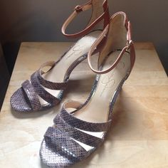 Snakeskin heels Jessica Simpson snakeskin heels never been worn. A comfortable shoe with a 4' heel and support around the ankle. Jessica Simpson Shoes Heels