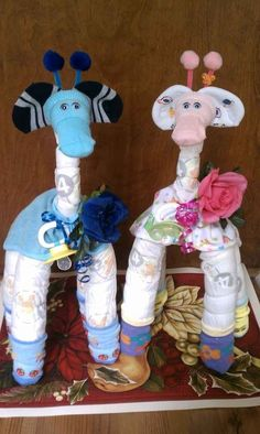 Giraffes. How fun would it be to have a diaper cake contest at a baby shower! Instead of gifts everyone bring their best diaper cake!