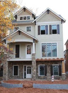 Architectural Designs House Plan 75558GB, designed for a lot that slopes to the front. 3 beds, 3.5 baths, 3,300+ sq. ft.  Ready when you are. Where do YOU want to build?
