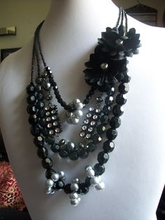 Black Orchid  Three Strand Necklace with clear and solid black beads with faux gray pearls and flower