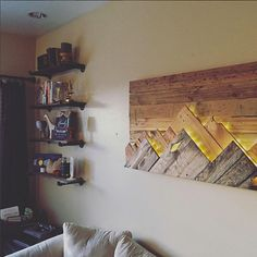 Wood Wall Art - Wooden Mountain Range Art  Made to Order or customize this look: This artwork is made up of upcycled wood scraps. Wood was trimmed to size and stained with traditional and hand made stains. The piece features two mountain ranges that stand out from each other based on their color and both mountain ranges also come backlit with micro LEDs. The LEDs are very warm and are connected to a battery pack that contains 4 AAs. There is a small switch on the lower right side that you…