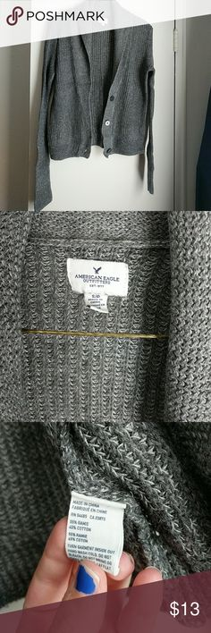 Grey american eagle cardigan Grey American Eagle cardigan with buttons. Size small. The arms are a bit long but if you fold them up as cuffs they look great! American Eagle Outfitters Sweaters Cardigans