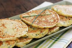 Squash pancakes made with summer yellow squash and fresh garden chives. A perfect summer side dish to eat with chicken, meat or fish.