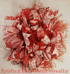 Peppermint Twist Deco Mesh Wreath  Follow my facebook board https://www.facebook.com/pages/Kristins-Deco-Mesh-Wreaths/737064886316432?ref=bookmarks