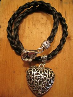 Black round braided horse hair necklace with silver heart charm <3