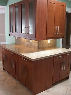 a nice corner in a rental unit with adel medium brown cabinets and under - Medium Brown Kitchen Cabinets