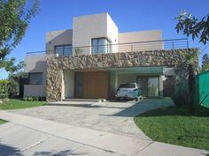 VIVIENDA VISTAPUEBLO I: Casas de estilo moderno por Arq. Leticia Gobbi & asociados