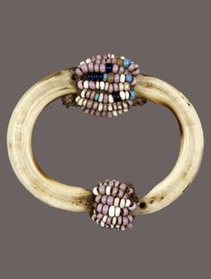 Africa | A Congo Basin Tusk Pendant with Beads from DR Congo; possibly Mongo people | 1st half of the 20th century | Tusk, glass beads, fiber | POR
