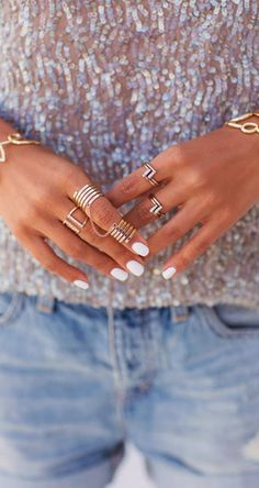 White nails + gold rings.